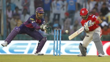 MS Dhoni's eyes light up as the ball goes past Manan Vohra's edge