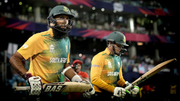 Hashim Amla and Quinton de Kock walk out to bat