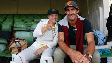 Alyssa Healy celebrates with Mitchell Starc after the win