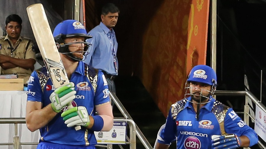 Martin Guptill and Parthiv Patel walk out to the field