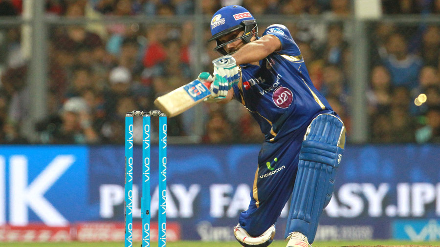 Rohit Sharma drives elegantly through the covers