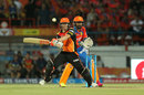 David Warner gets into an awkward position for a pull, Gujarat Lions v Sunrisers Hyderabad, IPL 2016, Rajkot, April 21, 2016