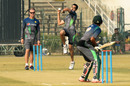 Grant Flower watches Umar Gul bowl during a practice session in Lahore, January 2, 2016