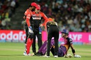 Royal Challengers Bangalore players check on Kevin Pietersen after he picks up an injury, Rising Pune Supergiants v Royal Challengers Bangalore, IPL 2016, Pune, April 22, 2016