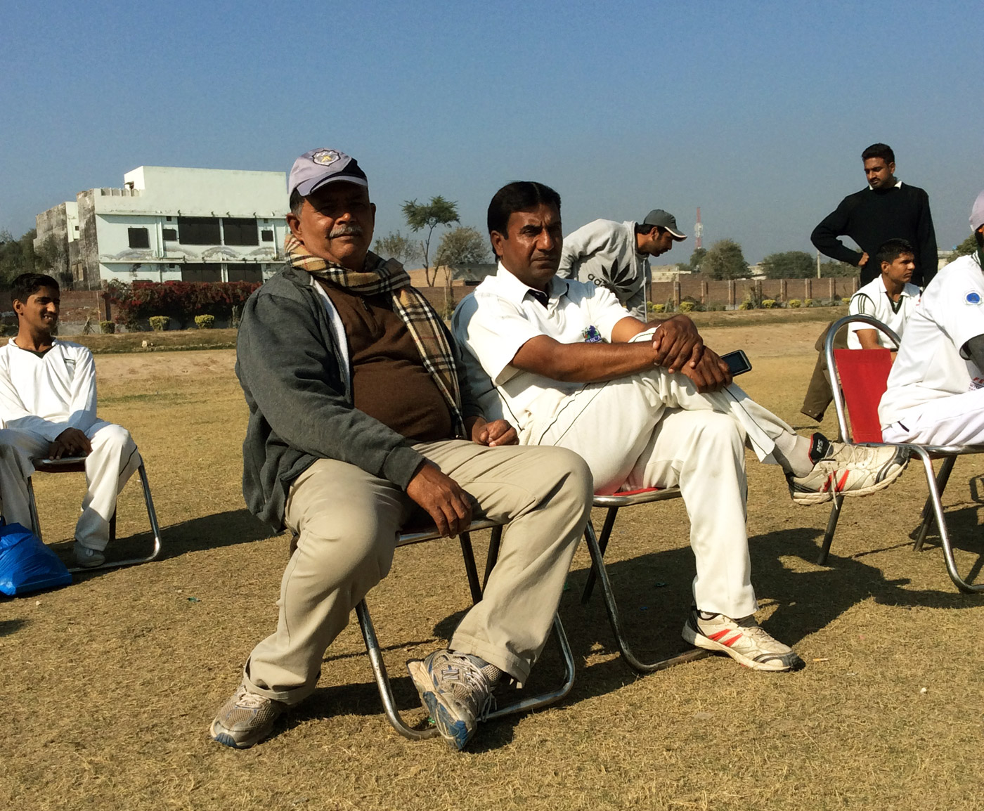 Abdul Haye (left) and Naveed Ahmad, coach and captain of Fazl-e-Umar, struggle to hold on to talented players, who move to the West in search of better lives and cricketing opportunities