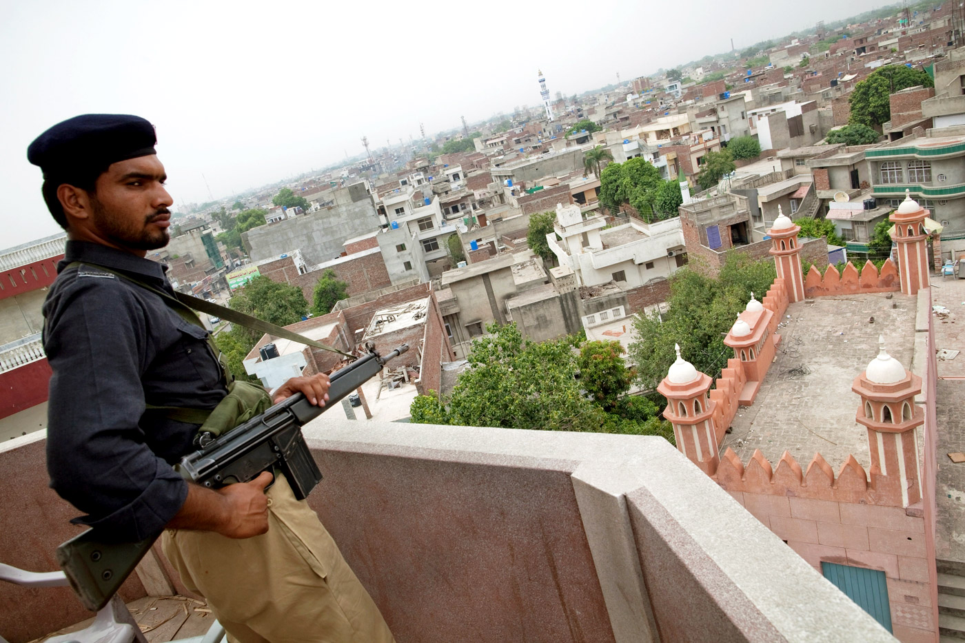 A policeman guards Garhi Shahu mosque, an Ahmadi place of worship in Lahore, which was attacked in May 2010