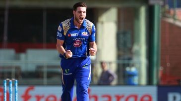 Mitchell McClenaghan is pumped up after dismissing Quinton de Kock
