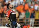 Virat Kohli is animated in celebration after reaching his century off the last ball of the innings, Gujarat Lions v Royal Challengers Bangalore, IPL 2016, Rajkot, April 24, 2016