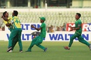 Muktar Ali is mobbed by his team-mates after sealing his side's tense win, Abahani Limited v Sheikh Jamal Dhanmondi Club, DPL 2016, Dhaka, April 26, 2016