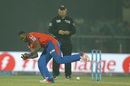 Dwayne Bravo tries to field the ball off his own bowling, Delhi Daredevils v Gujarat Lions, IPL 2016, Delhi, April 27, 2016
