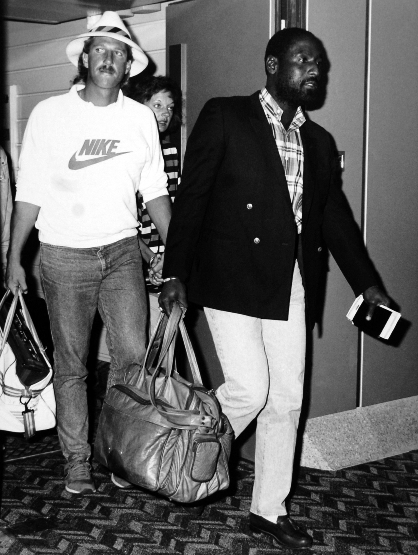 Ian Botham and Viv Richards arrive in London after the series