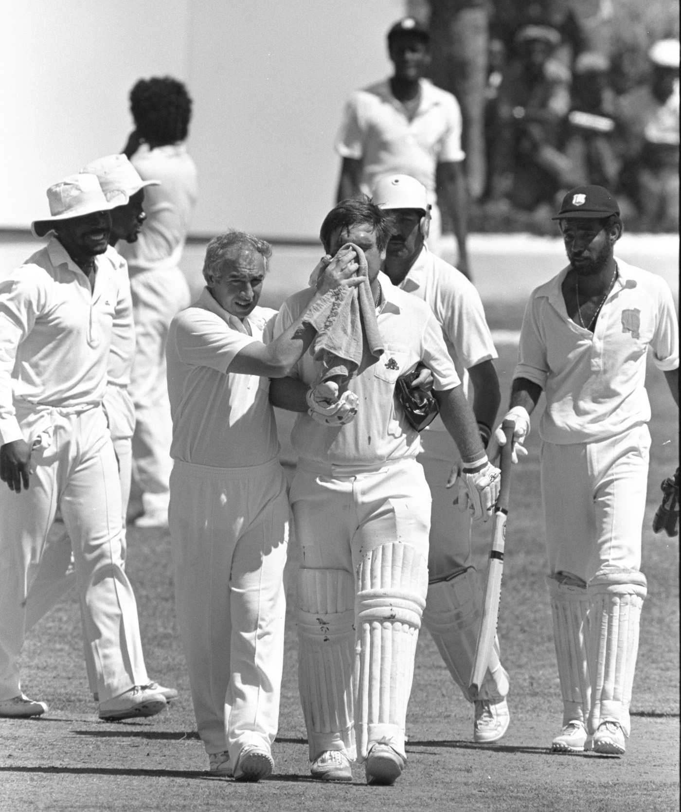 Mike Gatting is led off the field at Sabina Park after having his nose broken by a bouncer from Malcolm Marshall
