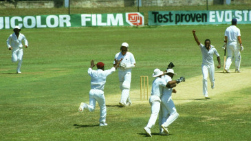 Ian Botham is caught behind by Thelston Payne off Malcolm Marshall
