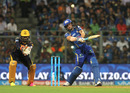 Jos Buttler muscles a big shot down the ground, Mumbai Indians v Kolkata Knight Riders, IPL 2016, Mumbai, April 28, 2016