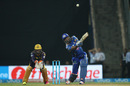 Kieron Pollard pings a mighty six down the ground, Mumbai Indians v Kolkata Knight Riders, IPL 2016, Mumbai, April 28, 2016