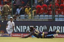 Andre Russell dives as he tries to stop the ball, Delhi Daredevils v Kolkata Knight Riders, IPL 2016, Delhi, April 30, 2016