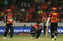 A frustrated Varun Aaron gets down on his haunches during David Warner and Kane Williamson's strong stand, Sunrisers Hyderabad v Royal Challengers Bangalore, IPL 2016, Hyderabad, April 30, 2016