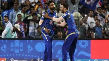 Krunal and Hardik Pandya celebrate the wicket of Ajinkya Rahane