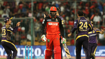 Chris Gayle walks back after being dismissed for 7 on his return to the side