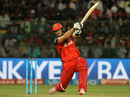 Shane Watson drills a ball through the off side, Royal Challengers Bangalore v Kolkata Knight Riders, IPL 2016, Bangalore, May 2, 2016