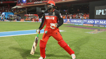 Chris Gayle walks out to bat after missing four games