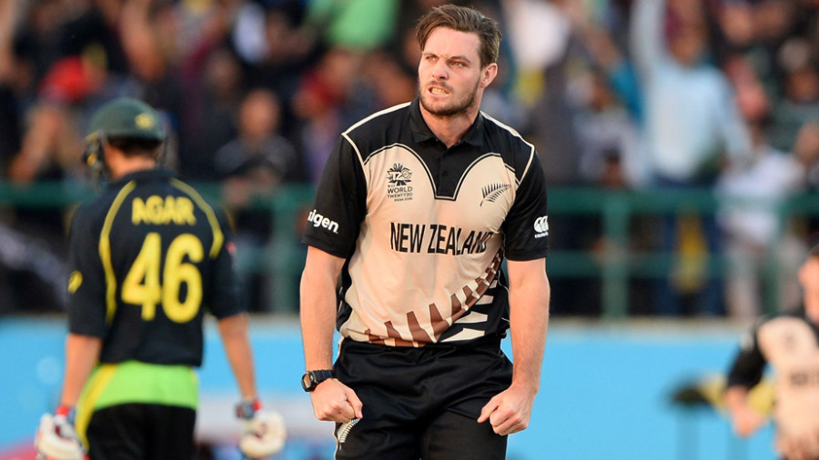 Mitchell McClenaghan celebrates the wicket of Mitchell Marsh