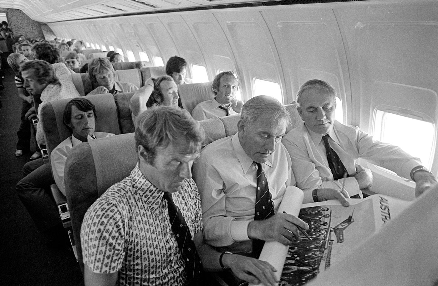 Who we gonna call? England's tour think tank, Alan Smith and Alec and Eric Bedser (from left), on the plane to Adelaide after the Perth Test
