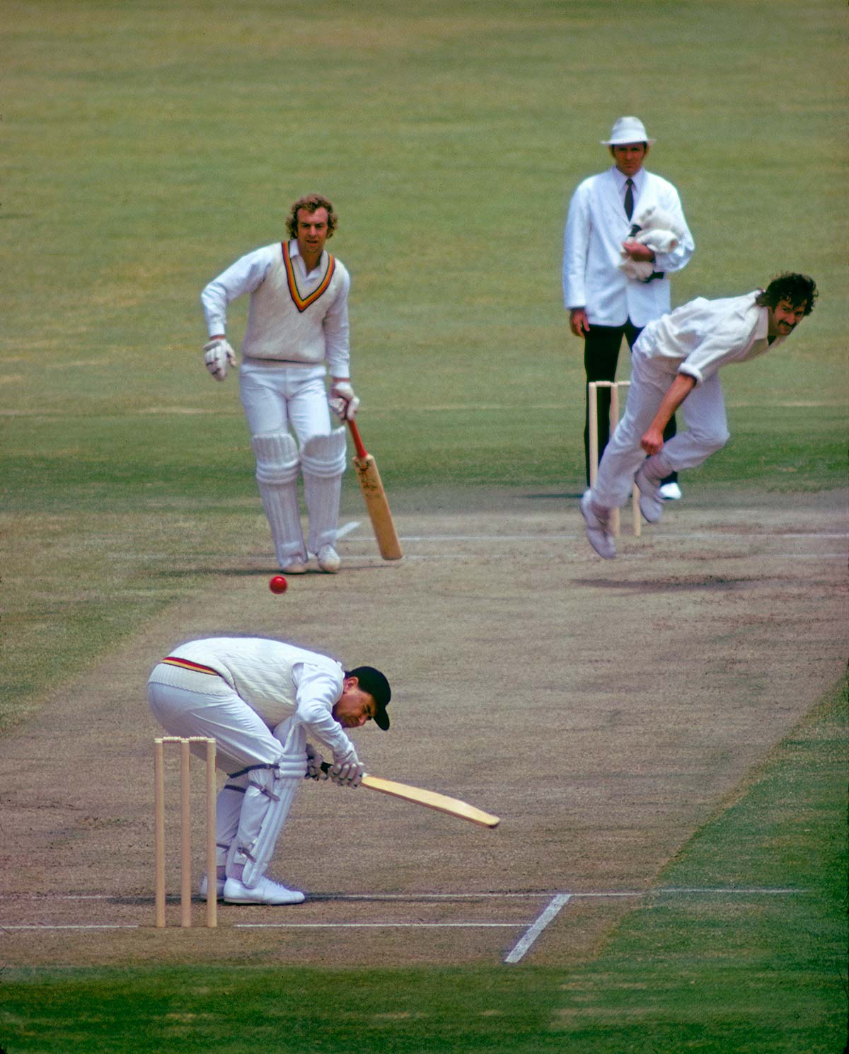 Colin Cowdrey ducks a short ball from Dennis Lillee