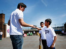 Alastair Cook gets a fist bump at a Chance to Shine event in Bethnal Green, London, May 5, 2016
