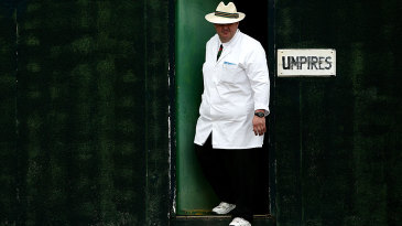An umpire steps out of the umpires' room at Marchwiel Cricket Club in Wales