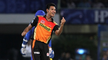 Mustafizur Rahman is pumped up after taking a wicket