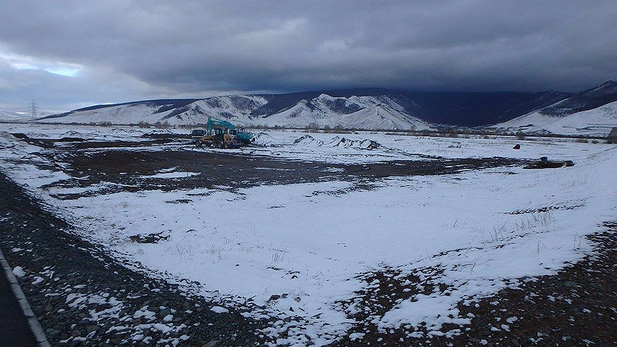 The snow-covered scene as Mongolia's first cricket ground gets underway