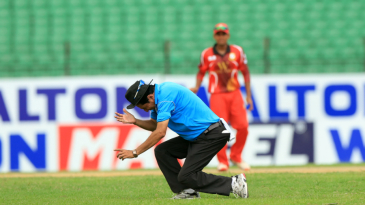 Umpire Nadir Shah collapses after being hit on the forehead