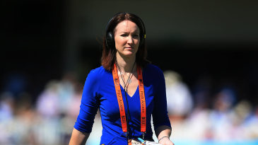 Commentator Alison Mitchell walks across the ground