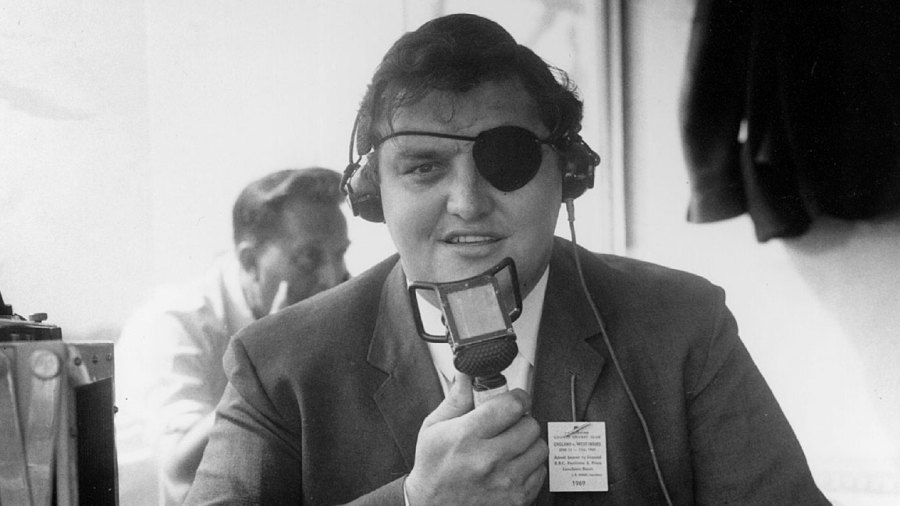 Colin Milburn, wearing an eyepatch after his accident, does commentary for the BBC