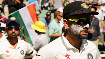 Virat Kohli leads his players out in his first Test as captain