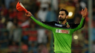 Royal Challengers Bangalore captain Virat Kohli acknowledges the crowd after his team's 144-run win