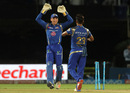 Jos Buttler and Vinay Kumar celebrate the wicket of Mayank Agarwal, Mumbai Indians v Delhi Daredevils, IPL 2016, Visakhapatnam, May 15, 2016