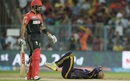 Andre Russell is on the floor after slipping on the followthrough, Kolkata Knight Riders v Royal Challengers Bangalore, IPL 2016, Kolkata, May 16, 2016