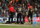 Andre Russell is attended to after injuring himself, Kolkata Knight Riders v Royal Challengers Bangalore, IPL 2016, Kolkata, May 16, 2016