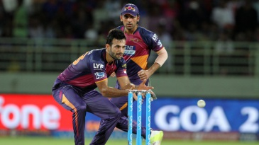 Irfan Pathan is a picture of concentration as he collects the ball