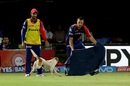 Nathan Coulter-Nile tries to lure a dog out of the field after it interrupts play, Rising Pune Supergiants v Delhi Daredevils, IPL 2016, Visakhapatnam, May 17, 2016