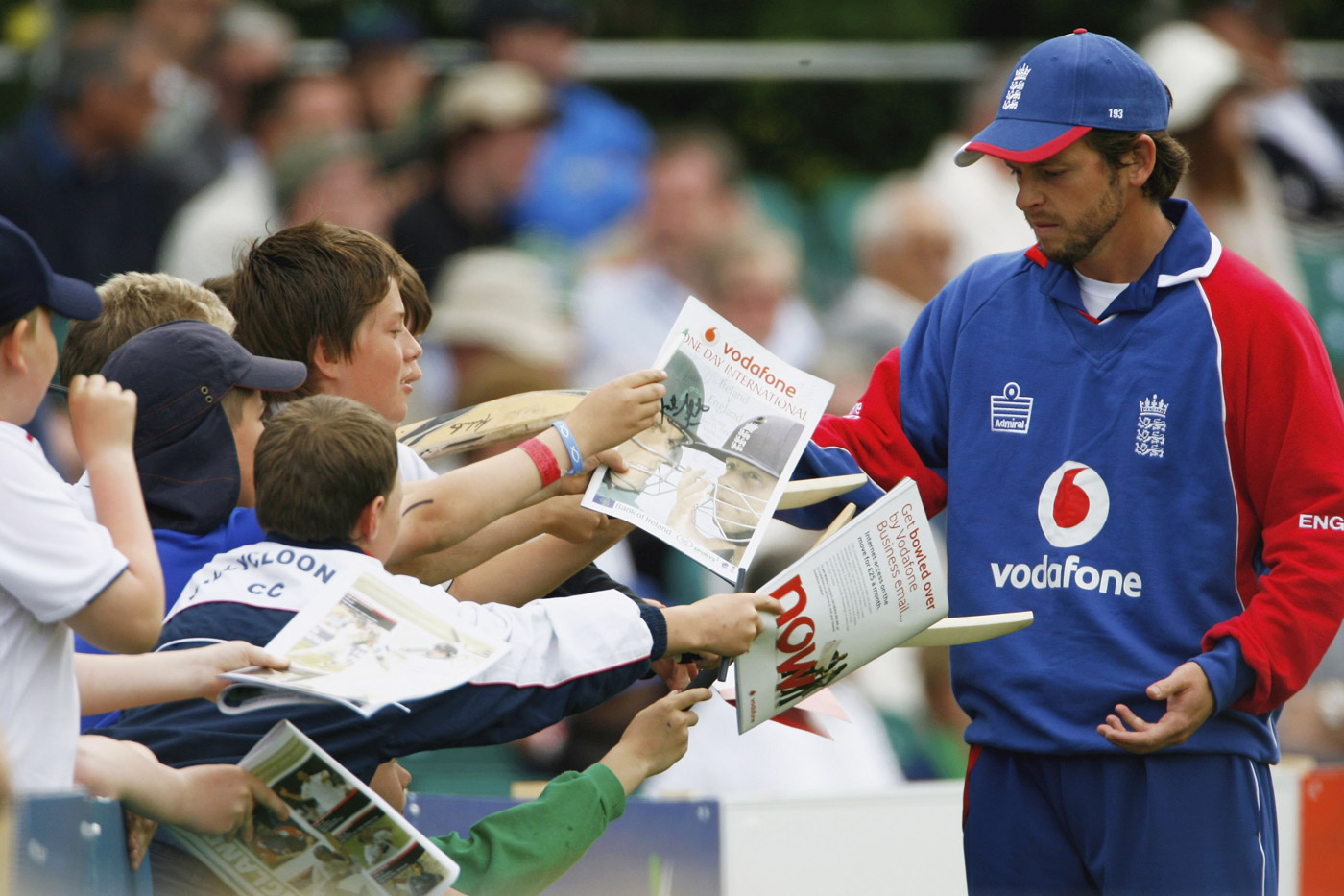 The switch: Ed Joyce wears England colours while signing autographs for kids in Belfast, 2006