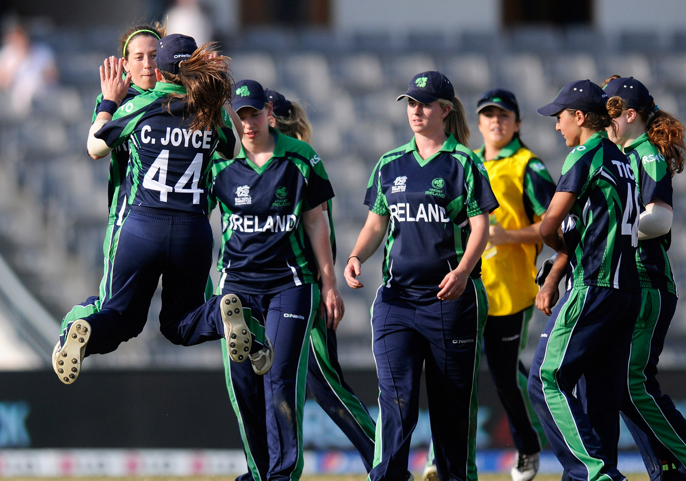 Isobel and Cecelia celebrate a wicket against South Africa in the 2014 World T20