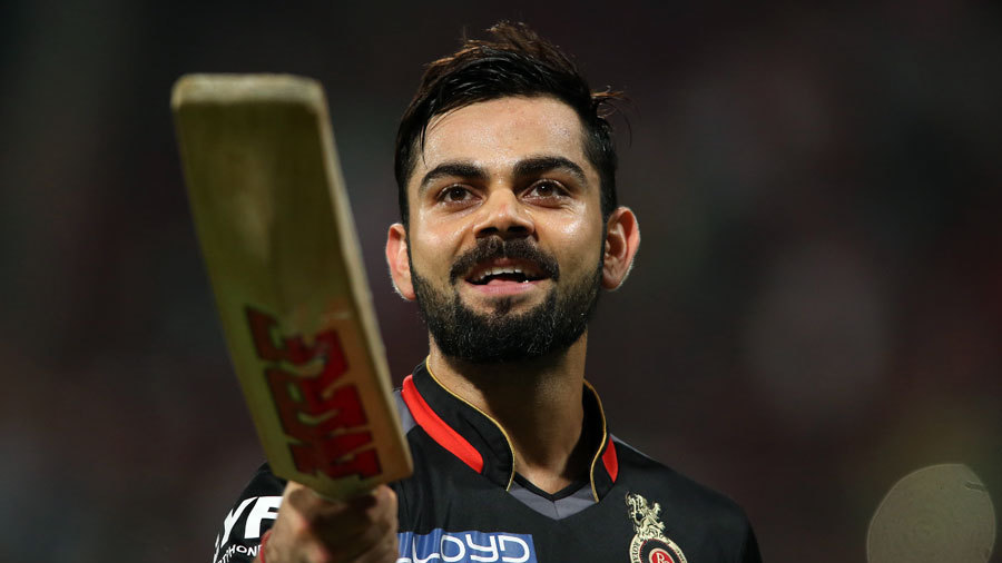 Virat Kohli enjoys the moment after getting to his fourth ton of IPL 2016