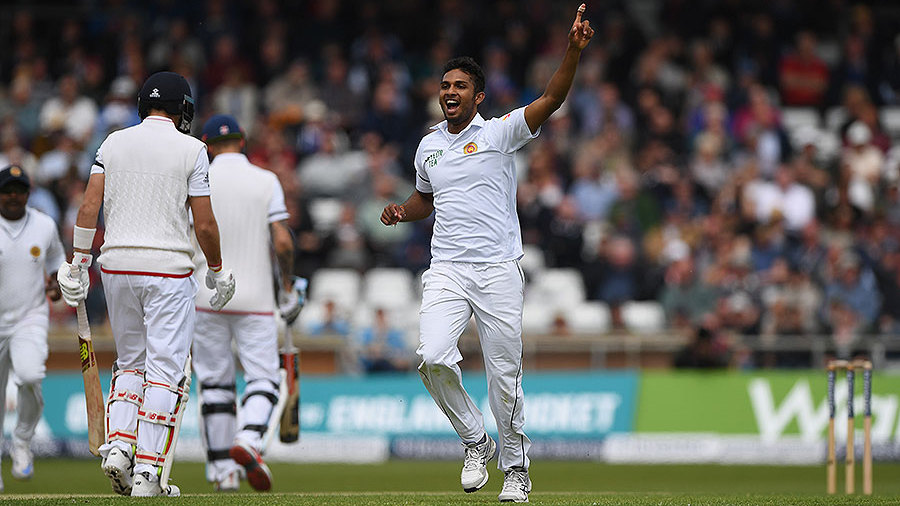 Dasun Shanaka celebrates the dismissal of Joe Root for 0