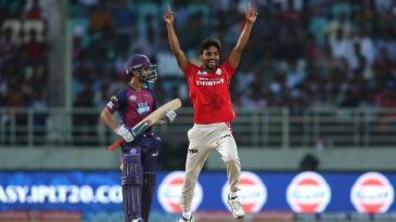 Sandeep Sharma celebrates the wicket of Ajinkya Rahane