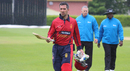 Captain Peter Gough walks off after rain forced play to stop with no result, Jersey v Oman, ICC World Cricket League Division Five, St Saviour, May 21, 2016
