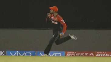 Virat Kohli gestures after taking an outstanding catch running back