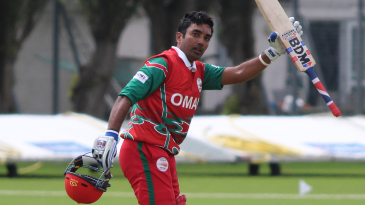Aamir Kaleem salutes his team-mates after reaching a half-century